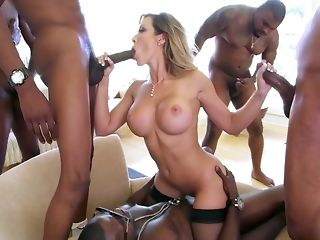 5 dark-hued plowers are excitingly massaging plus penetrating one mind-blowing milky dame porn tube