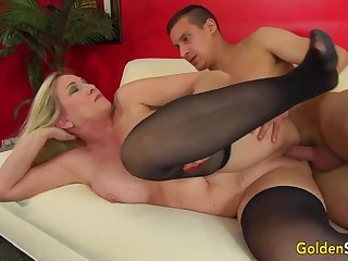 Towheaded matured bi-atch in dark-hued pantyhose, Cala Thirsts is penetrating a junior boy like a superslut
