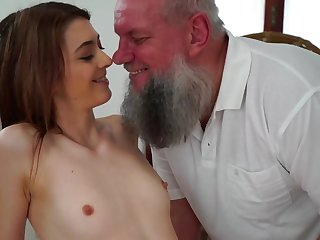 Teen cutie is stroking coupled with sucking old guy on the rub-down committee